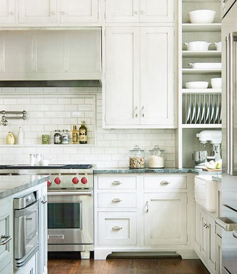 The Backsplash Adds Instant Vintage Appeal The Simple Backsplash Complements The Traditional Detailing Found On The Pale Gray Shaker Style Cabinetry