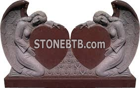 Red headstone granite monument with angel heart shape