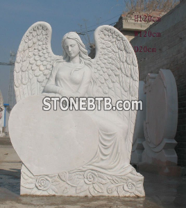 White marble headstone angel tombstone with heart shape