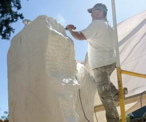 Sculptor shapes 14 ton chunk of marble